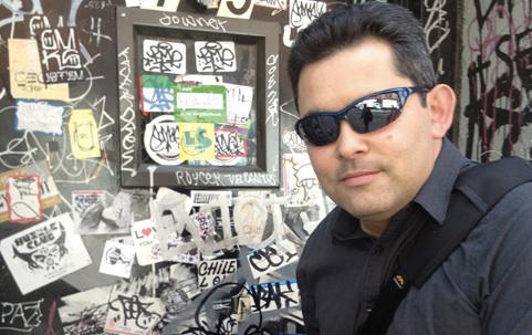 Journovation Chair Dan Pacheco in front of the unmarked Kickstarter office door.