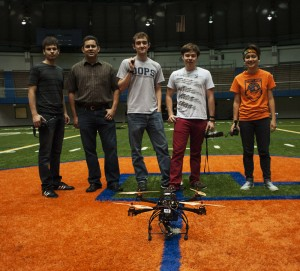 Participants of the first indoor drone test flight at Syracuse University's Manley Field House on October 4, 2013. From left to right: Prof. Dan Pacheco, Pacheco and SU students Jay Getman, Arland Whitfield and Erin Miller.